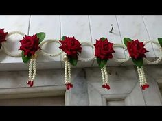 # toran, Moti ring with red rose gorgeous# toran Diy Crafts Love, Cool Paper Crafts, Diy Crafts For Gifts, Diy Arts And Crafts, Diwali Diy, Diwali Craft, Diwali Decoration Items, Handmade Decorations, Door Hanging Decorations