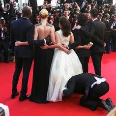 Who's the guy who put his head up America Ferrera's skirt at Cannes? www.handbag.com Celebrity Gossip, Celebrity News, Cannes Film Festival 2014, Djimon Hounsou, America Ferrera, Creepy Guy, Audrey Tautou, Cate Blanchett, Bridesmaid Dresses