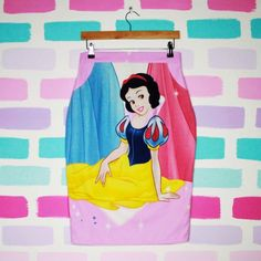 Upcycled Snow White pencil skirt  Size UK 10/12  Only one ever made - Measurements are * Waist 28 inches * Hips 40 inches * Length of skirt (from waist) 27 inches - Handmade in Edinburgh by Thrifty Little Please contact me with any questions #disney #disneyprincess #snowwhite #pink #cartoon #cosplay inspiredby #jeremyscott #skirt #pencilskirt #pastel #upcycled #reworked #unique #princess