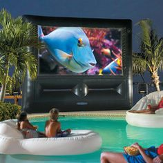 When we get the epic pool, spa and outdoor kitchen! Inflatable SuperScreen Outdoor Theater System - Ultimate Home Theater! Cheaper than a huge big screen tv. Living Pool, Outdoor Living, Giant Water Slide, Water Slides, Inflatable Movie Screen, Piscine Diy, Backyard Movie Theaters, Paris Home, Outdoor Theater