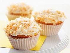 Lemon-Filled Coconut Cupcakes : Sandra's simple cupcakes feature a secret ingredient that's a nice complement to the lemon flavor: coconut milk.