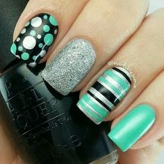 Mint green with black and silver nails. Polka dots and stripes.