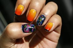 Abstract nail art with yellow blue orange and pink