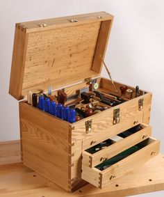 Hollow areas down the sides of the drawers to store long tools upright.