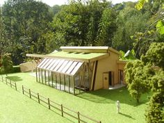 Part of Eco village - unusual earthen roof home with large greenhouse/solarium feature