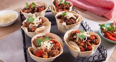 Add these mind-blowing tortilla cups to the menu! Impress your guests with this take on Chilli Con Carne.  #snack #delicious #recipe