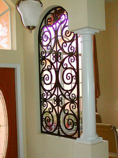 The room divider/partitoner looks like it is made of wrought iron but it is actually custom made from a composite wood material - faux iron. Tuscan Decorating, Porch Decorating, Home Room Design, House Design, Unique Front Doors, Drawing Room Furniture, Wrought Iron Decor, Tuscan Design, Tuscan Style