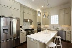 1215 Wynden Commons Ln - The elegant kitchen hosts all Viking appliances, a 6 burner stand-alone gas range, wonderful work space, tall cabinets, a U-line wine chiller in the island, and large pantry.