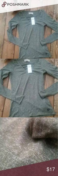 V Neck Sweater V Neck long sleeve sweater  Light weight  Cute detail at chest  Available in 3 colors  -Green -Burgundy -Charcoal Gray All posted Hollister Tops Tees - Long Sleeve