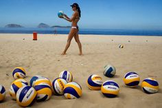 In this March 20, 2012 photo, Brazil's Talita Antunes prepares to serve during a beach volleyball training match on Ipanema beach in Rio de Janeiro, Brazil. Antunes and her teammate Maria Elisa Antonelli are one of the favorite teams to compete at the London 2012 Olympic games women's beach volley event. (AP Photo/Victor R. Caivano)