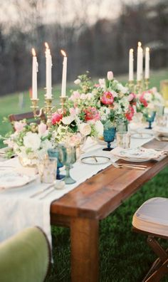 Lauren Gabrielle Photography; Breathtaking outdoor wedding reception with romantic centerpiece
