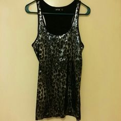 Tank top Black and silver shiny tank top. In good shape. Apt. 9 Tops Tank Tops