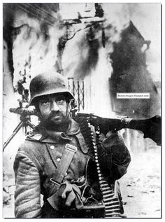 Vision of hell. German machine-gunner in the burning heart of Zhitomir. Ukraine, in November 1943. The town fell to the Russians on November 12, 1943
