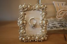 Make one of these for the kitchen, can hang your ring while you do dishes/clean! Add vintage jewelry to a small frame. Cover backboard with layer of cotton or cork & cover with coordinated fabric; add decorative pin and hang your ring while doing dishes!