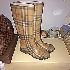Auth Burberry rain boots These boots have been worn maybe a handful of times. Really looking to purchase the Burberry Check Panel rain boots instead. These are in good condition Shoes