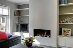 Look at the picture of the cloeck, with the title sleek fireplace with cabinet, in the upper room and other inspirational images Welke. Fireplace With Cabinets, Fireplace Built Ins, Gas Fireplace, Modern Fireplace Decor, Living Room With Fireplace, Living Rooms, Lounge Design, Room Inspiration, Interior Inspiration