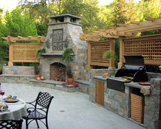 Beautiful Fireplace & Patio Kitchen by Derviss Design