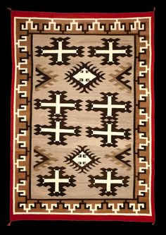Navajo Spider Woman Cross Rug with Multiple Spirit Lines, Newcomb Trading Post. A spirit line is a yarn that symbolizes a path to exit from a box (the border) to the edge of the rug. Some weavers believed their spirit would not be trapped in a box if they had an exit. However, not every rug has a spirit line, because some weavers did not have the same belief. Legend says that the Navajo learned how to weave from the Spider Woman. More Navajo textiles for sale on CuratorsEye.com