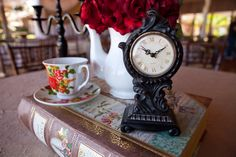 Beauty and the beast wedding center piece.  Photo by Jaime Tardiff with Aptera Studios, best wedding photographer! Would highly recommend!