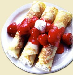 cheese blintzes w/ cream and berries