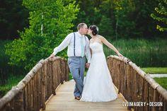 Kissing couple photo on woodland bridge.   Dixon's Apple Orchard and Wedding Venue, Chippewa Valley, WI