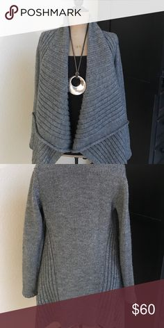 Trapeze Style Gray Sweater Knit Cardigan This wool, acrylic and alpaca blend sweater knit cardigan is gently worn and from Express  online collection. It is very flattering on and can be belted or pin collar for a cowel look at neckline.  Great length for skirts dresses and leggings. NOTE: Necklace not included. Express Sweaters Cardigans