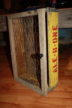 old pop crate with a chicken wire front door. Looks like a great combination.
