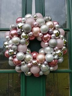 SHADES OF PINK....  A beautiful soft pink and silver bauble wreath.  Masses of different textures and finishes combine to give this an elegant chic feel.  Attached to a solid polystyrene base it would look gorgeous on your door whether inside or out!  Stunning as it is it looks even better with a scroll attached!  This beauty measures approx 47cm across and as you can see from the pictures in substantially built up with balls making it a real statement piece.  The scroll comes separately and…