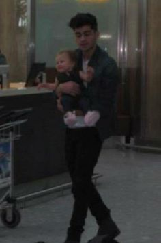 Zayn and Baby Lux at the airport