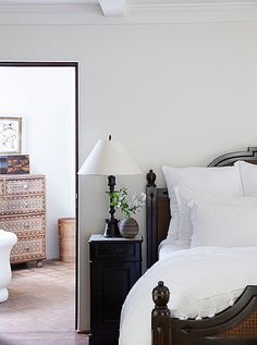 The master suite is a serene, breezy retreat with a striking wood-and-wicker bed and set of custom nightstands by Brenda Antin. Nightstand essentials?