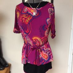 Poly multi color cranberry red tunic top Classy looking cranberry red paisley print tunic with ribbon tie belt and accented ribbon on sleeves with gold button, slits at hem.  Travel friendly. Pair up with your favorite black jeans.  Charter Club Tops Tunics