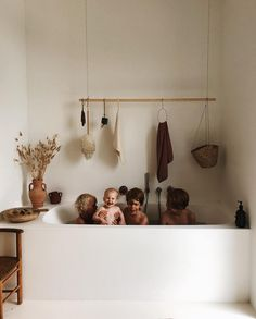 White and wood / natural family bathroom with DIY wooden rail for storage / Tessa Hop