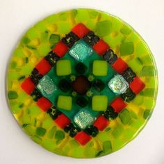 By Deb Altman met the circle challenge with a stunning mix of glass: opals, transparent, iris, and dichros. We slumped this into a bowl. Awesome!