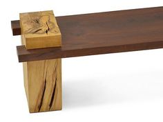 Handcrafted solid wood bench made with a single slab of walnut and base in teak wood. The stunning Walnut Bench is a heirloom-quality piece perfect to center yo