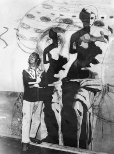 """Dalí in his studio in front of the first stages of """"Hallucinogenic Toreador,"""" 1968."""