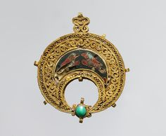 "Pendant [Egypt] (30.95.37) | Heilbrunn Timeline of Art History | The Metropolitan Museum of Art ""Few works with enamels have survived from the early Islamic period. The fabrication of this pendant is typical of Fatimid goldsmiths' craftsmanship: boxlike construction, gold stringing loops, openwork design with a strip support, S-shaped filler elements, and paired twisted wires. The enamels had to be secured to the back with an adhesive after the object was finished"""