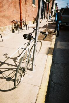 pittsburgh bicycle with crutch carry-all. Bell+Howell focus free 28mm lens, 400ISO generic film