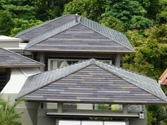 """Millennium Forms large cupped tiles in """"Slate Grey"""" on a roof in Singapore"""