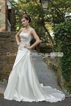 wedding dress. love the train, the flower straps, the wrap look. backless possible? bodice could be a different shape...