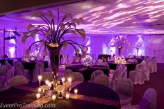 Love the calla lilly centerpieces and the votives, Would love to do the vellum wine glass lamps