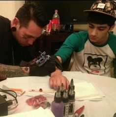 Tattoo artist ,John Bahel, added some new ink to already tatted up One Direction's Zayn Malik and added some ink to fellow band member Louis Tomlinson. The boys have had a wild time in New York City. All of them with their girlfriends except for Niall Horan who did get some lip action on David Letterman Show! So John talks about the boys new ink and what it's like to hand with these guys.