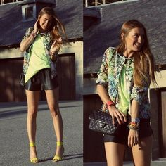 Give neon shorts a makeover with a blast of brights and a hint of floral. Phot courtesy of Lookbook.nu