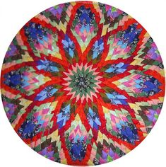 DIY flower carpet from recycled material. good site for making it. Коврики-кругляши...LiveInternet - Российский Сервис Онлайн-Дневников