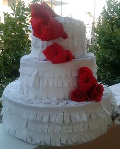 Wedding cake with flowers that co-ordinate with the colours of the brides flowers ..