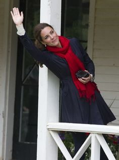 Catherine, Duchess of Cambridge wave as Prince William, Duke of Cambridge takes part in helicopter manouvres called 'water birding' across Dalvay lake on July 4, 2011 in Charlottetown, Canada.