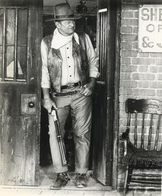 "The Duke - wearing his ""Red River D"" belt buckle"