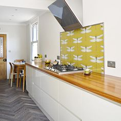 Step by step guide on how to create your own DIY splashback with wallpaper.