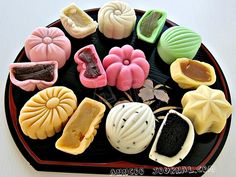 Anncoo Journal: Snowskin Mooncake.  I love the look of the white one with the flecks of black sesame - now where do I get the molds. . . and pandan leaves?