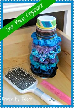 Cover a 99 cent gift mailer with fabric for a cute, inexpensive way to organize scrunchies and hair bands!