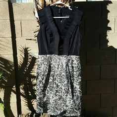 """BCBG MAX AZRIA Black & Silver Dress BCBG MAX AZRIA Black & Silver Dress. With Pockets. Zipper on side. Size 10. Fully lined. Self: 48% Cotton, 37% Polyester, 15% Metallic. Contrast: 100% Polyester. Lining: 100% Polyester. When laying flat from top of dress to bottom is 38"""", across chest from armpit to armpit is 19"""", waist: 15.5"""". No rips, tears, or defects. Comes from a smoke free home. No trades, no holds, thank you. BCBGMaxAzria Dresses Midi"""